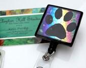Fused dichroic glass badge reel - Rainbow Pawprint