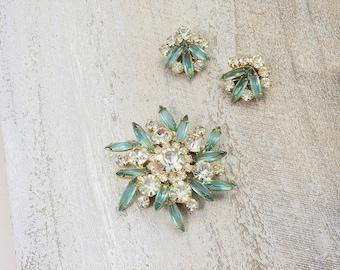 Confirmed DeLizza & Elster Juliana brooch and earrings set. Blue zircon navette and crystal rhinestones. Designer vintage set.