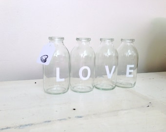 LOVE is in the air. Four upcycled glass mini milk bottles.Great WEDDING decor.