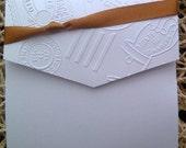 Elegant Embossed Vintage stamp pocket fold invitation with satin ribbon.