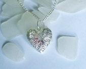 Sea glass locket. Rare red beach sea glass necklace. Sterling silver heart Locket.