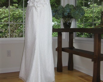White wedding dress with embroidered pearls through out the bodice. Cori