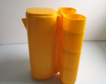 Plastic Stacking cups and Pitcher Set.  Vintage 1970's Modern, Panton era. Mid century. Yellow.