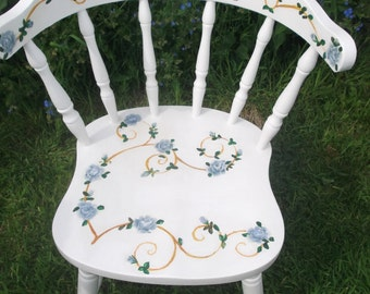 White wooden chair with hand painted blue roses.