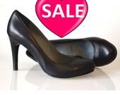 Office black leather pumps. On sale