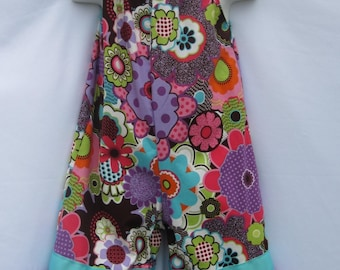 Multicolored Flower Jumpsuit with Ribbon Shoulder Ties and Double Ruffle Pants Legs