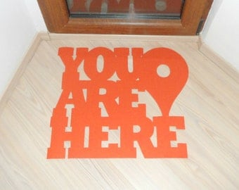 Door mat with Google maps pin: You are here. Custom floormat phrase