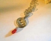 Necklace with Handmade Hammered Silver Swirl Charm and Carnelian Drop