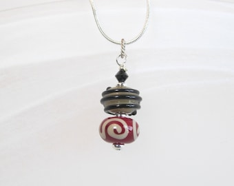 Necklace red, tan and black stacked glass lampwork beads with crystals
