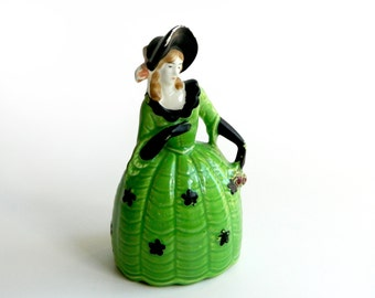 Figurine belle in green dress black hat & gloves flowers chippy chipped painted accents vintage kitsch collectible ceramic home decor c 1950
