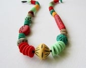 Relic series - necklace ii - A carved polymer clay necklace in coral red, mint, teal, peach, and taupe