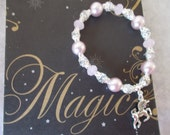 Believe In Magic, Enchanted Unicorn Charm Bracelet, Cloudy Pink Crystal Glass and Pink/Mauve Glass Beaded Bracelet, Corinne's Curiosity.
