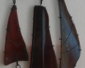 burgundy stained glass pedant, wearable from both sides, transparent.