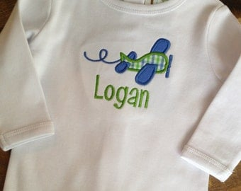 One-piece with airplane applique and name