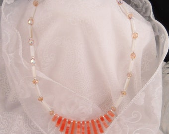 Graduated  coral gemstones, crystal and mother of pearl necklace