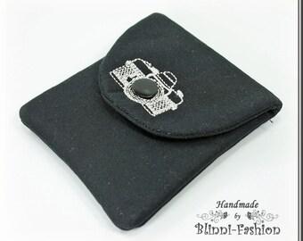 bag for camera accessories, lens cap, black