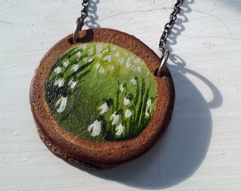 Wooden handpainted snowdrops pendant on a silver chain.