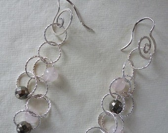 Argentium silver spiral earwires dangle diamond-cut chain capturing rose quartz rounds and faceted pyrites in silver orbit  Sparks Earrings