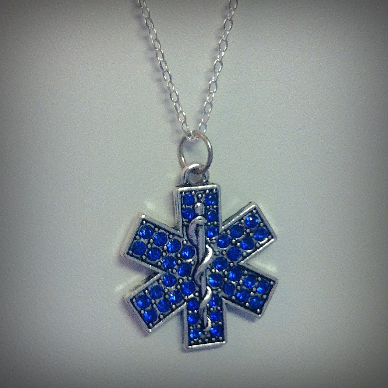 rhinestone star of life necklace