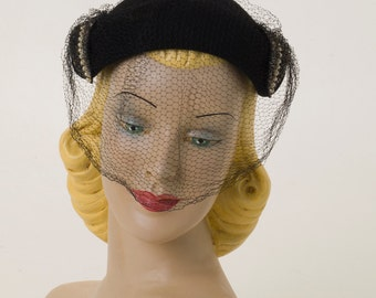 Black fur felt hat with beads and pearls and decorated veiling
