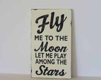 Fly me to the moon, distressed sign