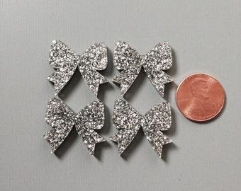 4x laser cut acrylic bow cabochons in Silver Glitter