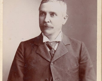 Antique Photo of Large-Eyed Gentleman with Mustache
