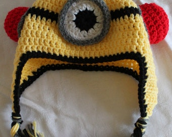 Crochet handmade one eyed minion hat. Bee-Do. Despicable me beanie with earflaps and long braids.