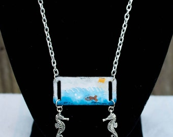 Enameled I.D. Necklace featuring an underwater scene