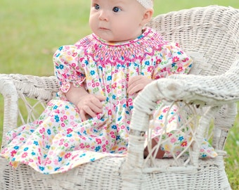 Hand smocked baby girls bishop dress, perfect for all seasons.  100% floral cotton fabric. 17790