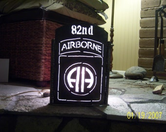 82nd Airborne, luminary. Totally hand built from mostly recycled or salvaged steel. Striking when lit.