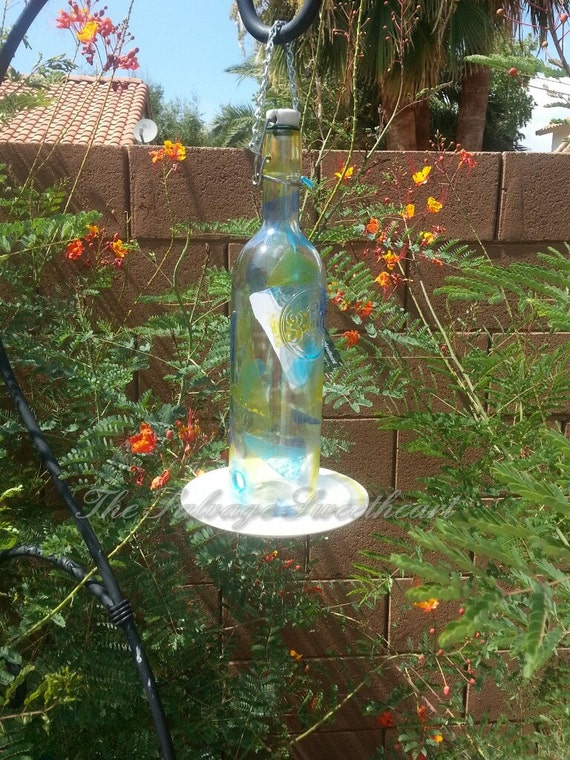Items similar to hand painted upcycled bottle bird feeder for Upcycled bird feeder