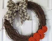 "18"" Grapevine wreath with chevron burlap bow and handmade burlap flowers"