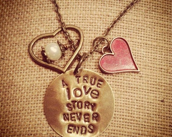 A true love story never ends hand stamped necklace.