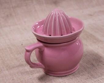 Vintage French pink ceramic citrus juicer with jug