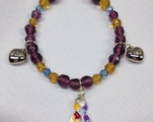 Autism bracelet - autism jewelry free shipping. Ribbon charm and two heart charms.