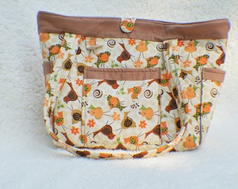 Little birdie gender neutral diaper bag, 4 outer and 8 inner pockets, measures 12 x 12 x 6