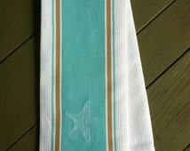 """Embroidered Starfish Kitchen Towel. Waffle Weave Teal & Sand color Kitchen Towel with delicate starfish. 16""""W x 28""""L 100% Cotton Woven"""