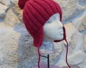 Unisex burgundy beanie winter ski hat with ear flaps and pom pom.