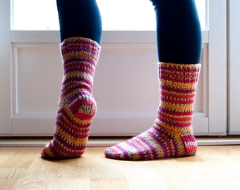 Knit wool socks in stripes of orange, red, yellow and pink hand knit socks