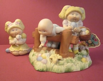 2 Cabbage Patch Kids Porcelain - 1985 Finding Easter Treats No 5477 and 1984 Girl Hugging Puppy