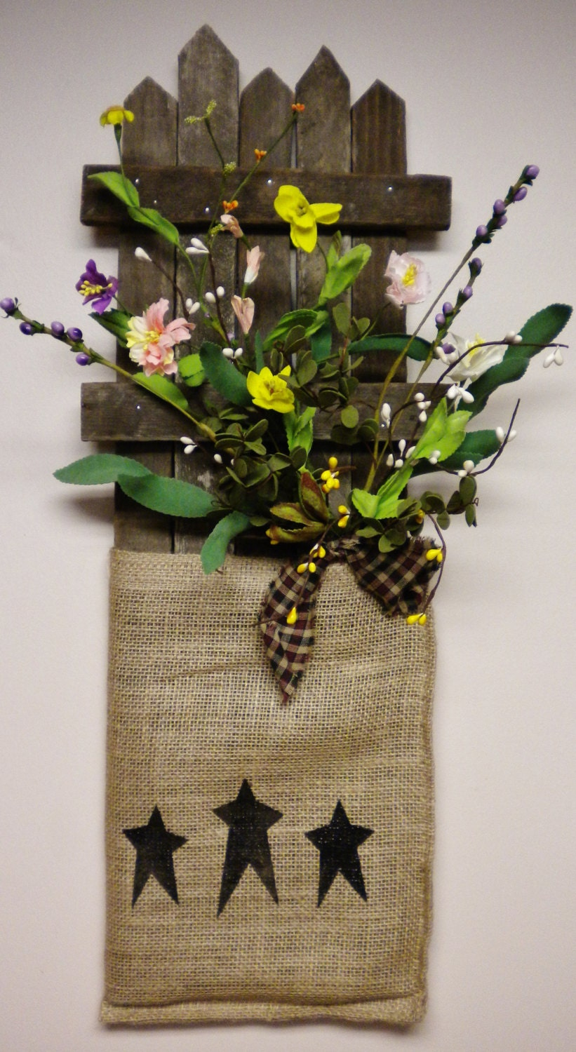 Tobacco Lath Wall Board With Burlap Sack Flower Arrangement