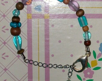 Simple Bracelet of Aqua and Lavender Glass Beads in Various Shapes with Wood Beads in Shades of Brown