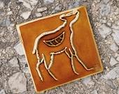 Petroglyph of a gazelle on a decorative handmade ceramic tile - fireplace or kitchen backsplash - glossy molasses brown