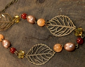 SALE Brass leaf necklace, antique brass leaves, carnelian stone, golden glass, peach beads, bronze pearl necklace