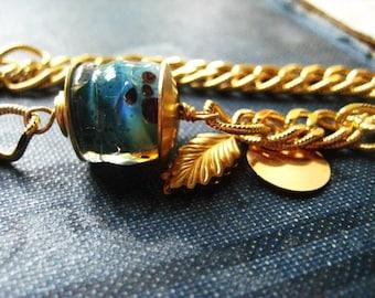 Lampwork bracelet, blue glass bead, vintage gold chain, golden chain, blue boro glass, leaf charm, blue lamp work, womens jewelry
