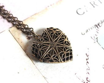 heart filigree. locket necklace. brass ox jewelry with a floral embossed back