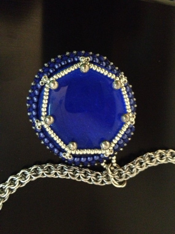 Royal blue glass pendant with metal chainmaille.