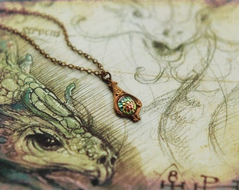Art Nouveau style necklace with vintage iridescent dragon scale glass in antiqued brass setting - Smaug