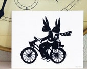 Rabbit and Hare Silhouette Bicycle Bunnies Paper Cut Silhouette Art Bunnies Bird Love A Bicycle Riding Couple